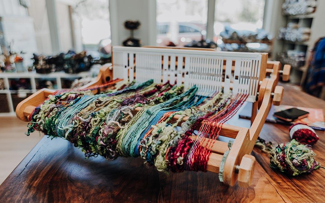 SAORI weaving with fun, colorful yarns on a rigid heddle loom