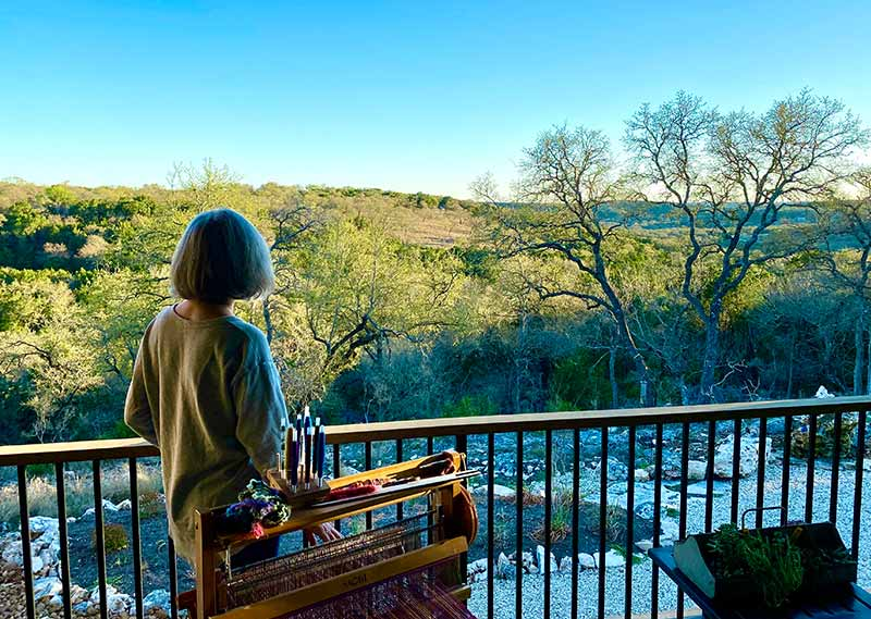 Wimberley Valley Saori owner Kathy Utts looking over the beautiful Texas Hill Country